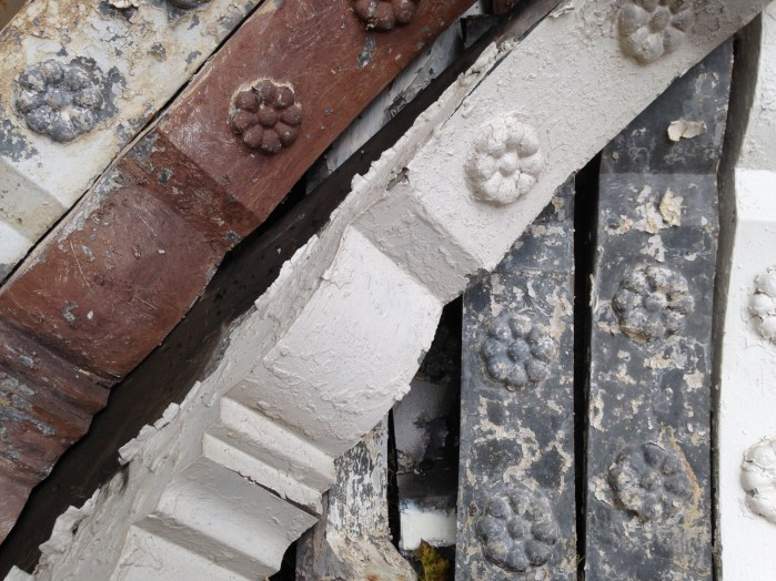 Cornice brackets can be used to help date a building- if the bracket is made of wood, the house was almost certainly built before 1892, when a new building code was adopted that required metal cornices as a fire-prevention measure.