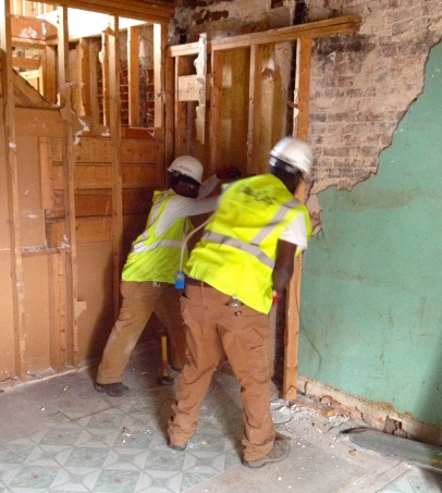 Many of the houses on Eager had been renovated several times over the last century. During this first week, crews have been stripping the houses back to the original plaster walls and pine flooring.
