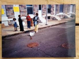Neighbors participate in a block cleanup.