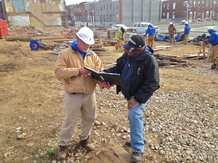 Bill (right) and site superintendent Chris look over the daily reclamation logbook. Photo was not staged, I promise.