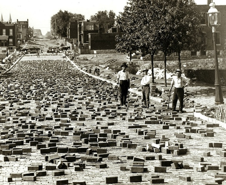 These men take a break from laying paving blocks. (Image courtesy of http://www.vintag.es)