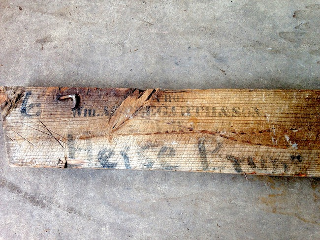 "It's hard to make out, but this joist features the stamp of ""Wm. APPLEGARTH & SON"" and the painted names of ""Heise & Bruns"""