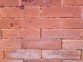 Weathered face brick from a mid 19th century house in West Baltimore